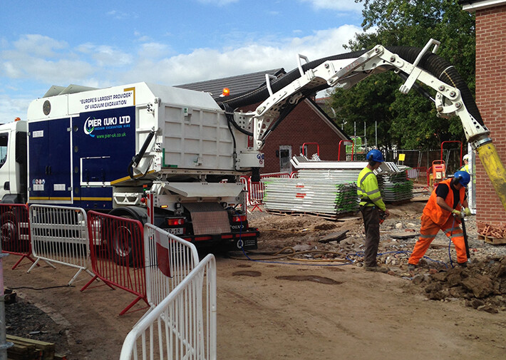 Vacuum excavator assist on house building site